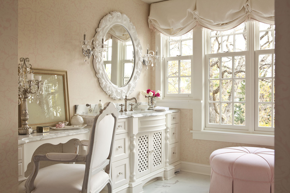 Inspiration for a large shabby-chic style master marble floor corner shower remodel in Minneapolis with furniture-like cabinets, white cabinets, marble countertops and pink walls
