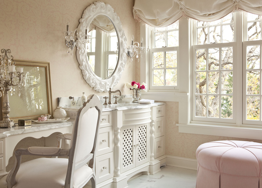 Example of a large cottage chic master marble floor corner shower design in Minneapolis with furniture-like cabinets, white cabinets, marble countertops and pink walls
