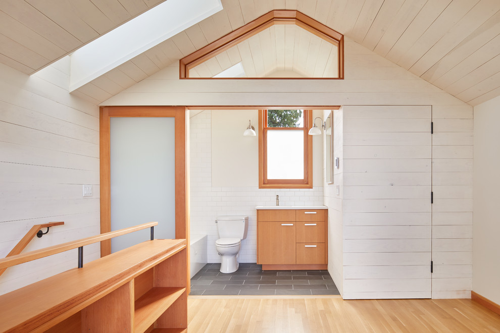Bathroom - small contemporary master white tile and subway tile slate floor and gray floor bathroom idea in Seattle with flat-panel cabinets, medium tone wood cabinets, a two-piece toilet, white walls, an undermount sink, quartz countertops and white countertops