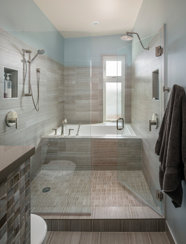 Example of a trendy beige tile and ceramic tile bathroom design in Seattle with blue walls
