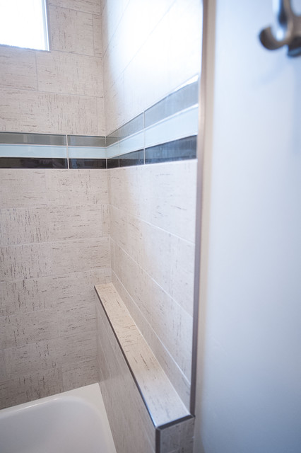 Example of a mid-sized trendy 3/4 beige tile, brown tile, gray tile and porcelain tile porcelain floor and multicolored floor bathroom design in Salt Lake City with shaker cabinets, white cabinets, an undermount tub, a two-piece toilet, gray walls, an undermount sink and solid surface countertops