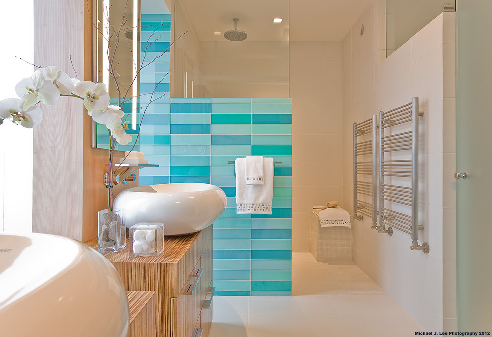 Bathroom - contemporary blue tile and glass tile bathroom idea in Boston with a vessel sink