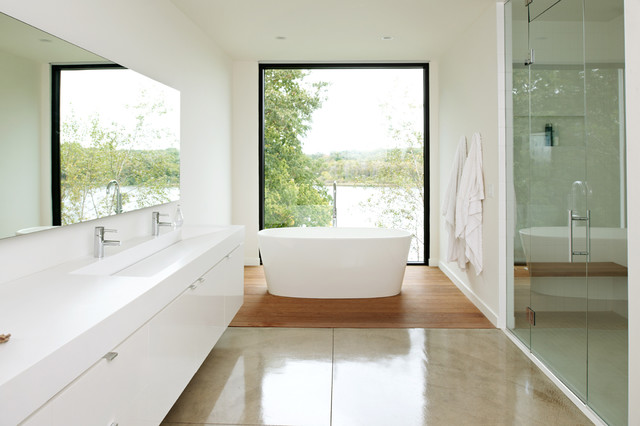 Bathroom - mid-sized modern master white tile concrete floor bathroom idea in Minneapolis with a trough sink, flat-panel cabinets, white cabinets and white walls