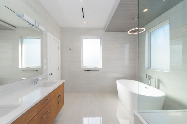 Bathroom - mid-sized transitional master white tile and porcelain tile porcelain floor and white floor bathroom idea in Vancouver with flat-panel cabinets, medium tone wood cabinets, a one-piece toilet, white walls, an undermount sink, engineered quartz countertops, a hinged shower door and white countertops