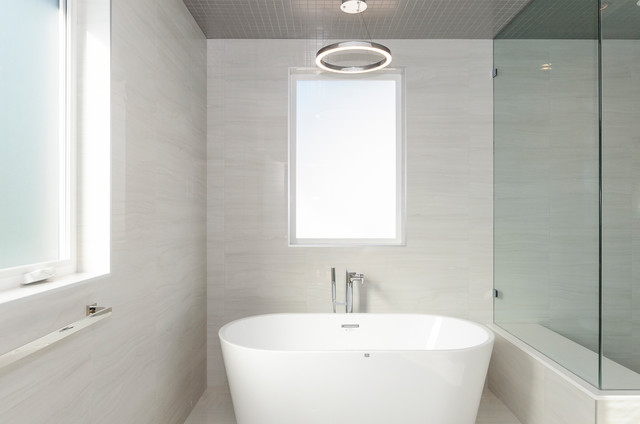 Inspiration for a mid-sized transitional master white tile and porcelain tile porcelain floor and white floor bathroom remodel in Vancouver with flat-panel cabinets, medium tone wood cabinets, a one-piece toilet, white walls, an undermount sink, engineered quartz countertops, a hinged shower door and white countertops