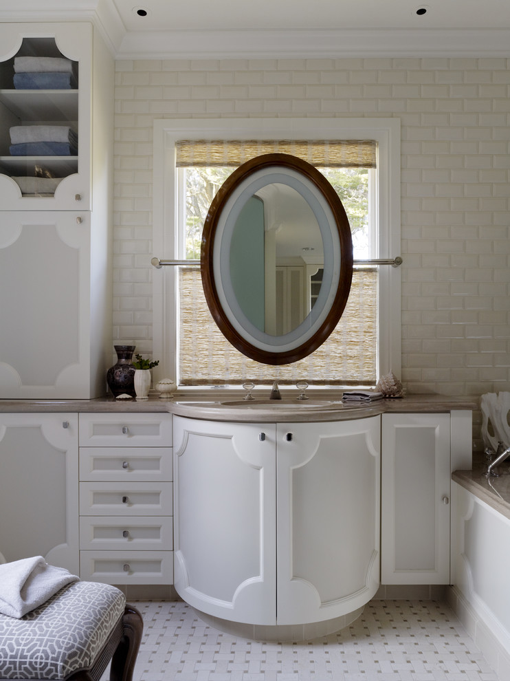 Trendy beige tile and subway tile bathroom photo in San Francisco with an undermount sink and white cabinets