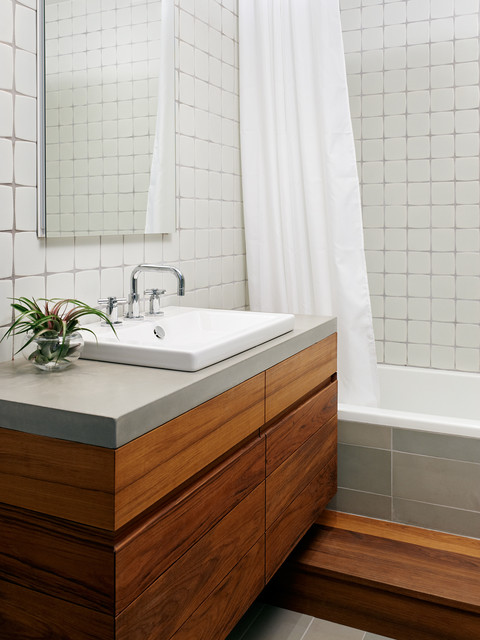 Photo Of A Contemporary Bathroom In New York With Concrete Worktops And Shower Curtain
