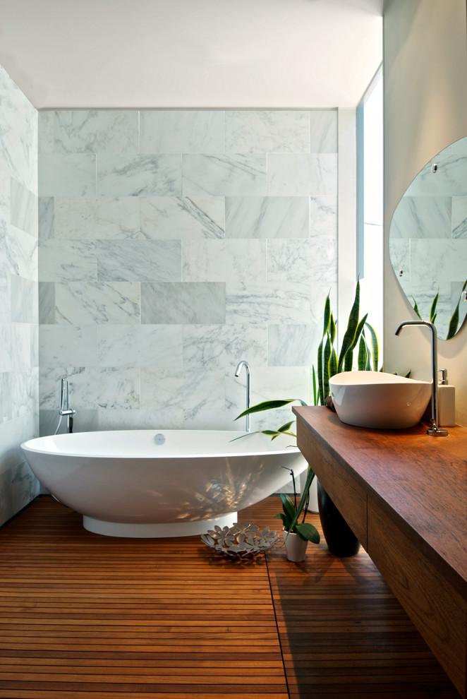 Bathroom - contemporary bathroom idea in Toronto with a vessel sink, wood countertops and brown countertops
