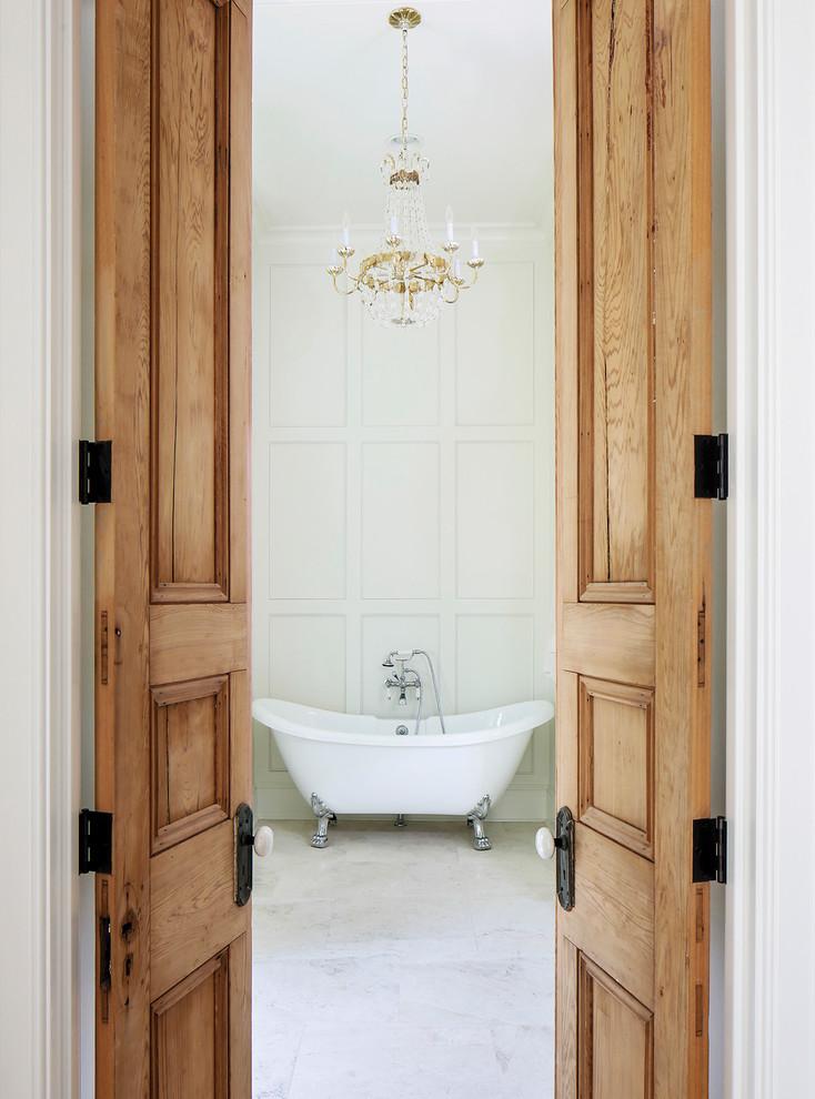Elegant white tile claw-foot bathtub photo in Nashville