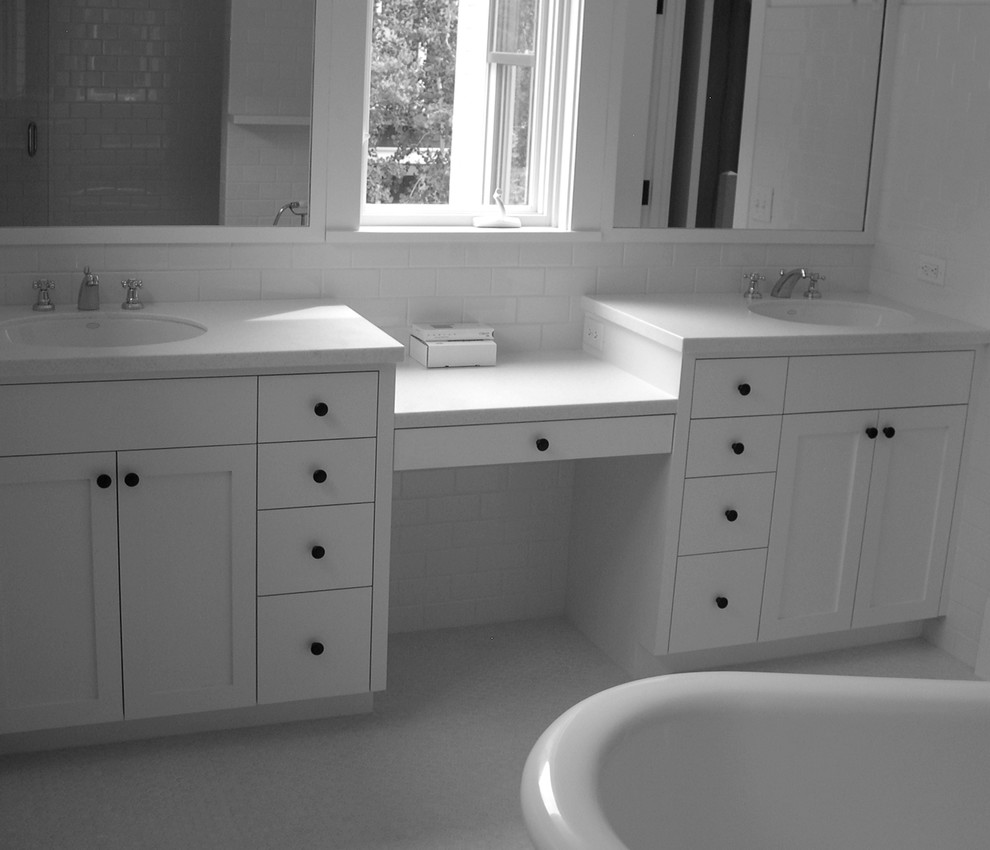 Freestanding bathtub - mid-sized transitional master white tile and ceramic tile mosaic tile floor freestanding bathtub idea in Denver with an undermount sink, shaker cabinets, white cabinets, solid surface countertops and white walls