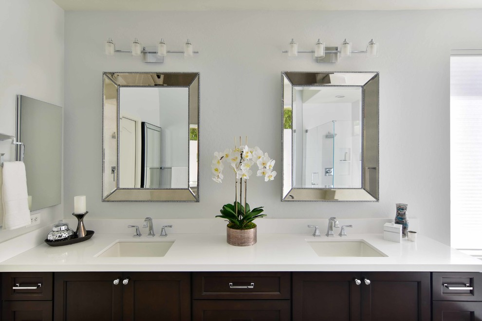Inspiration for a mid-sized transitional master white tile and ceramic tile bathroom remodel in Phoenix with recessed-panel cabinets, black cabinets, gray walls, an undermount sink, quartz countertops, a hinged shower door and white countertops