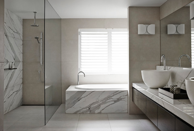 Photo of a large modern bathroom in Melbourne with a vessel sink, flat-panel cabinets, dark wood cabinets, marble worktops, a built-in bath, a built-in shower and marble tiles.