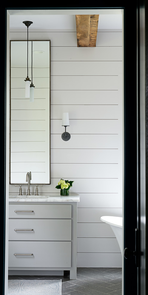 Example of a mid-sized transitional master porcelain tile and gray floor freestanding bathtub design in Other with blue walls, flat-panel cabinets, gray cabinets, an undermount sink and marble countertops