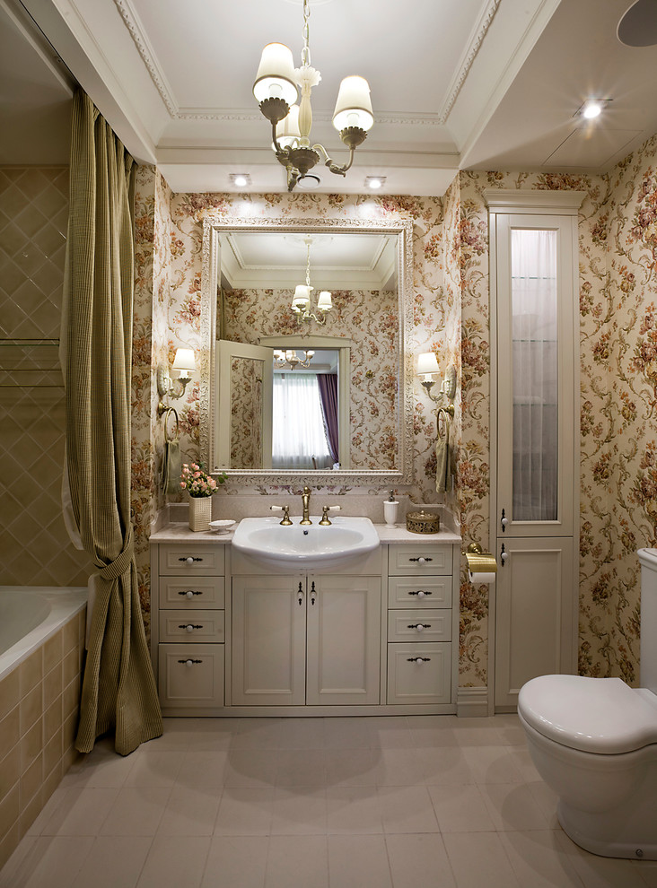 Elegant master beige tile and ceramic tile ceramic tile alcove bathtub photo in Moscow with multicolored walls, white cabinets, a drop-in sink, recessed-panel cabinets and a two-piece toilet