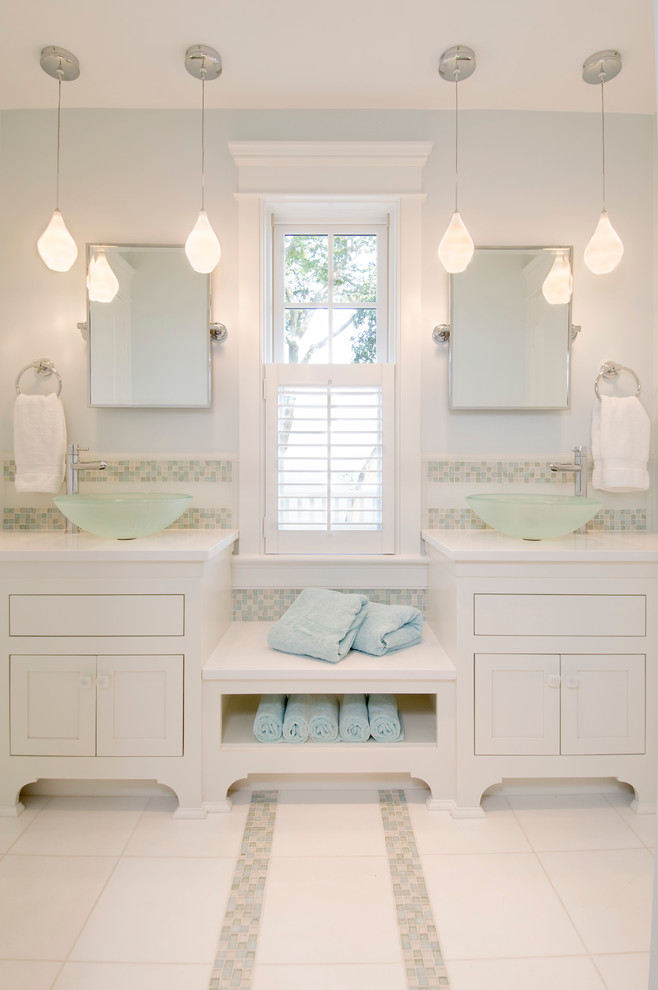 Example of a beach style bathroom design in Boston with a vessel sink and blue walls