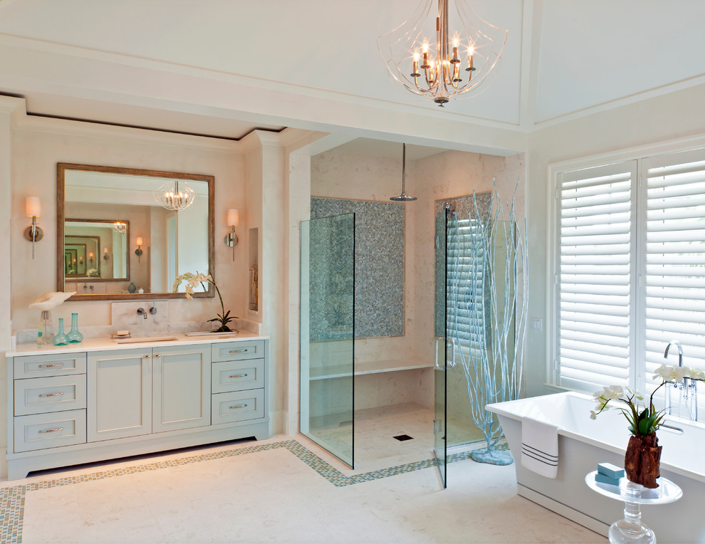 Bathroom - large tropical master blue tile bathroom idea in Miami with an undermount sink, shaker cabinets, blue cabinets and white walls