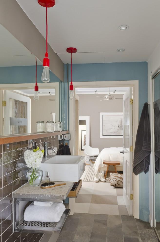 Bathroom - modern bathroom idea in Other with a vessel sink