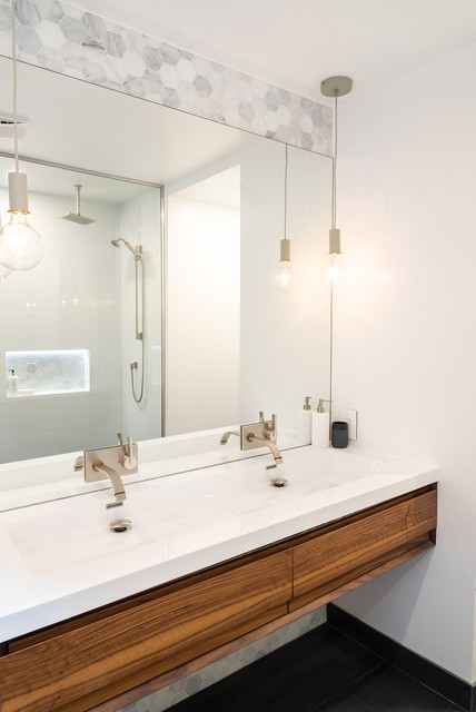 Design ideas for a modern 3/4 bathroom in Toronto with flat-panel cabinets and medium wood cabinets.