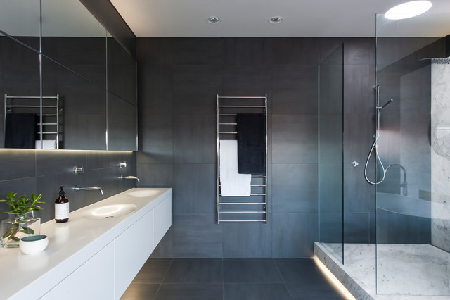 bathroom strip lighting. this is an example of a large contemporary master bathroom in sydney with integrated sink strip lighting