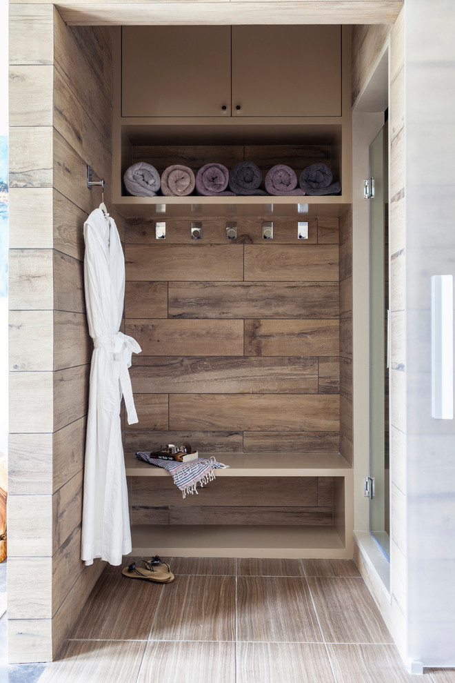 Inspiration for a small contemporary master bathroom remodel in New York with open cabinets and a hinged shower door