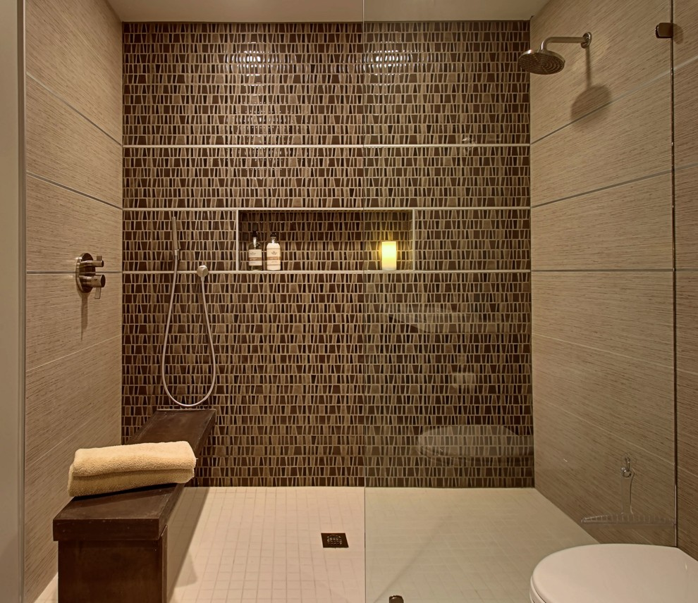 Example of a mid-sized mid-century modern beige tile bathroom design in Other with flat-panel cabinets, light wood cabinets, a one-piece toilet and beige walls