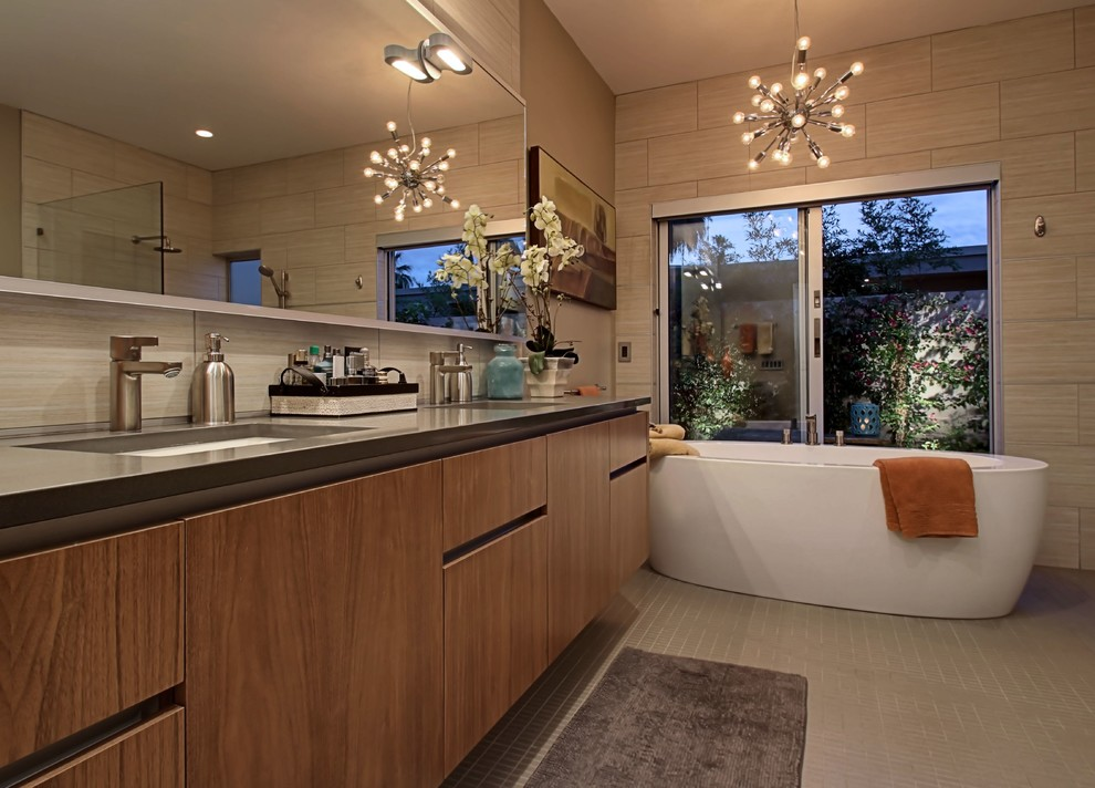 Inspiration for a large 1960s beige tile bathroom remodel in Other with flat-panel cabinets, light wood cabinets, a one-piece toilet and beige walls