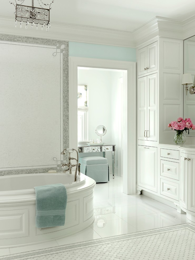 Inspiration for a coastal white tile white floor drop-in bathtub remodel in St Louis with raised-panel cabinets and white cabinets
