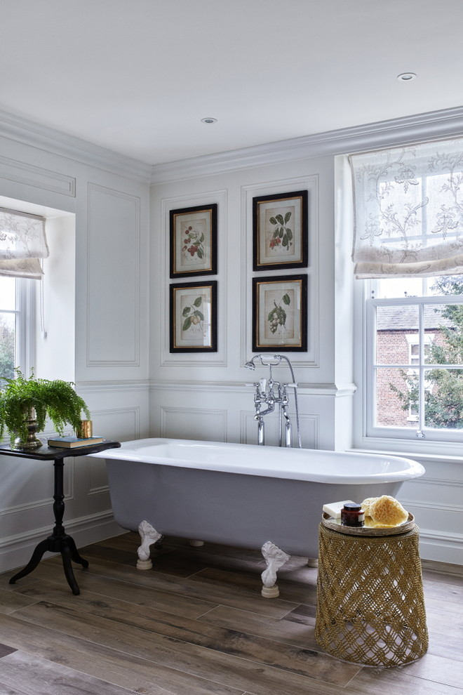 Example of a classic brown floor claw-foot bathtub design in Brisbane with white walls