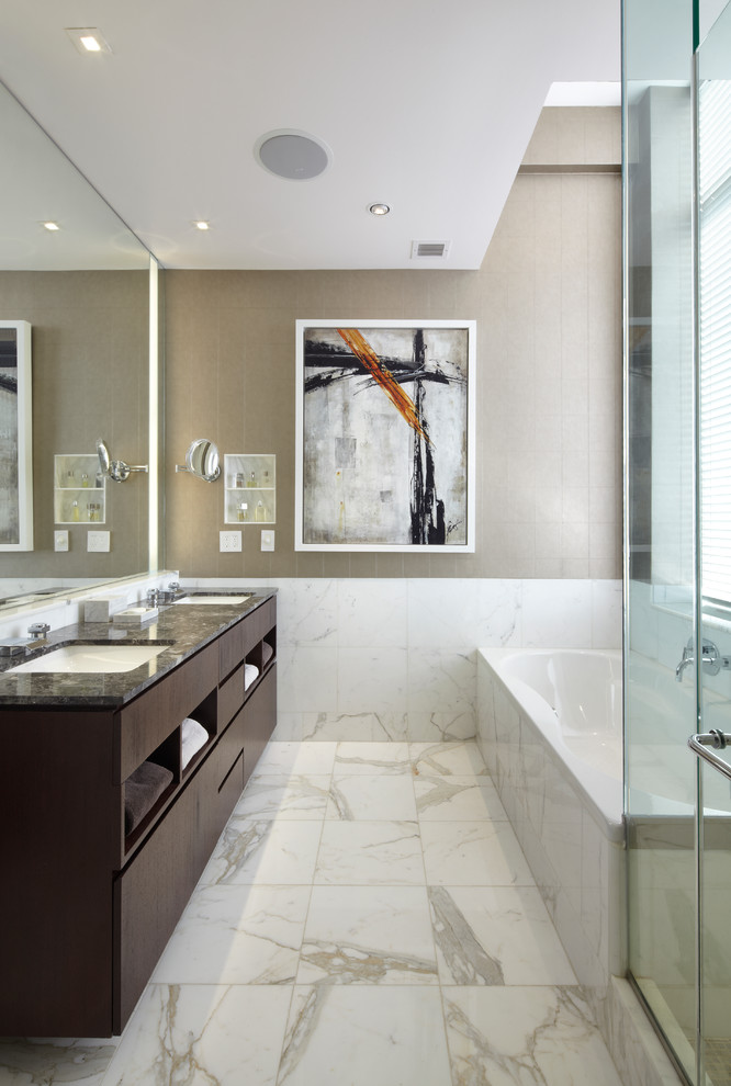 Inspiration for a mid-sized contemporary master white tile and porcelain tile marble floor and white floor bathroom remodel in New York with an undermount sink, flat-panel cabinets, dark wood cabinets, beige walls, granite countertops and a hinged shower door