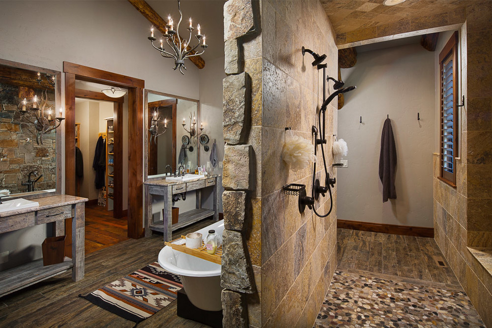 Inspiration for a large rustic master dark wood floor bathroom remodel in Other with flat-panel cabinets, distressed cabinets, a two-piece toilet, gray walls, a vessel sink and granite countertops