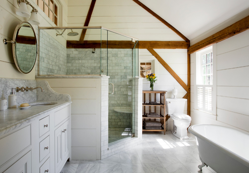 Mid-sized country master white tile and ceramic tile marble floor bathroom photo in Boston with white cabinets, marble countertops, white walls, an undermount sink, beaded inset cabinets and a two-piece toilet