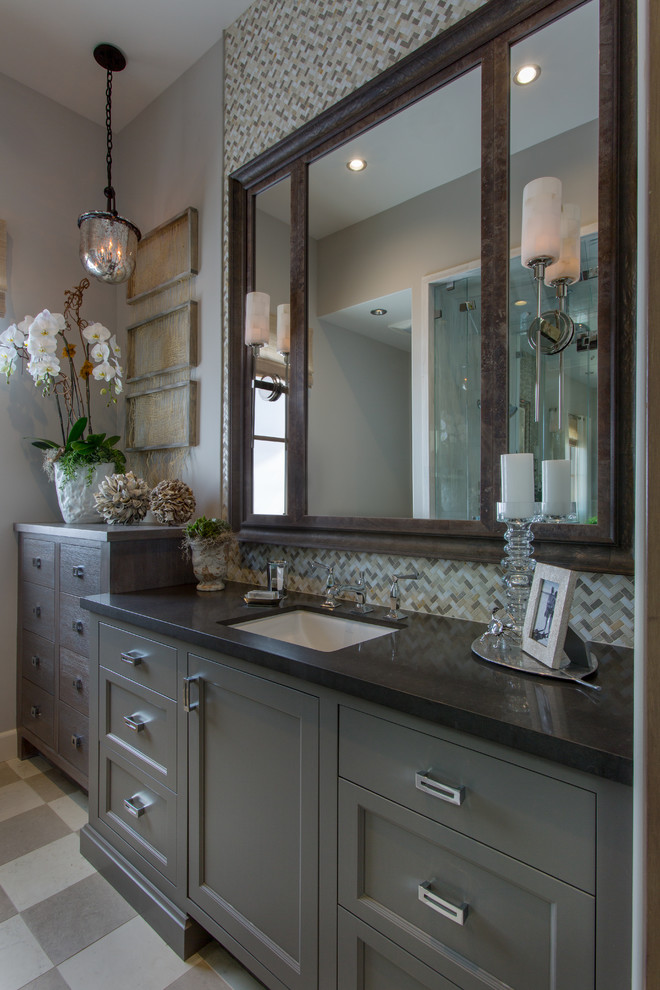 Large transitional master gray tile, white tile and mosaic tile ceramic tile and gray floor alcove shower photo in Orange County with quartz countertops, shaker cabinets, gray cabinets, a two-piece toilet, gray walls, an undermount sink and a hinged shower door