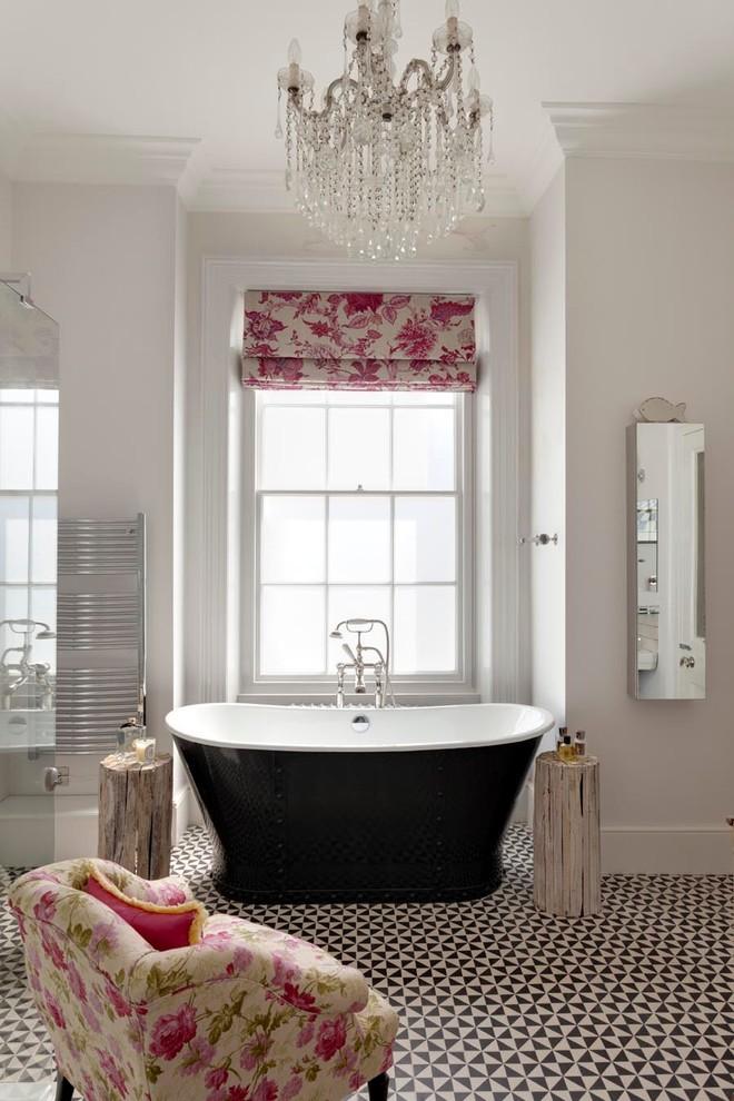 Freestanding bathtub - traditional master freestanding bathtub idea in Sussex with gray walls