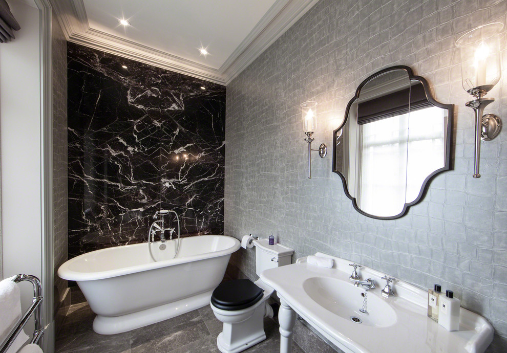 Freestanding bathtub - contemporary marble tile freestanding bathtub idea in Manchester