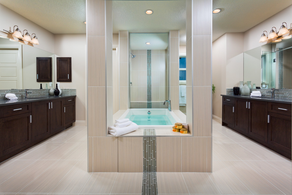 Example of a large trendy master gray tile and matchstick tile porcelain tile bathroom design in Calgary with shaker cabinets, dark wood cabinets, white walls and an undermount sink