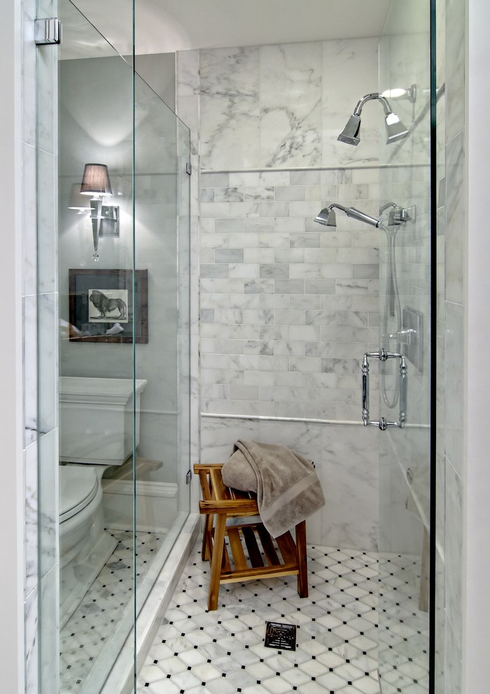 Elegant white tile alcove shower photo in Minneapolis with raised-panel cabinets, dark wood cabinets, gray walls, an undermount sink and granite countertops