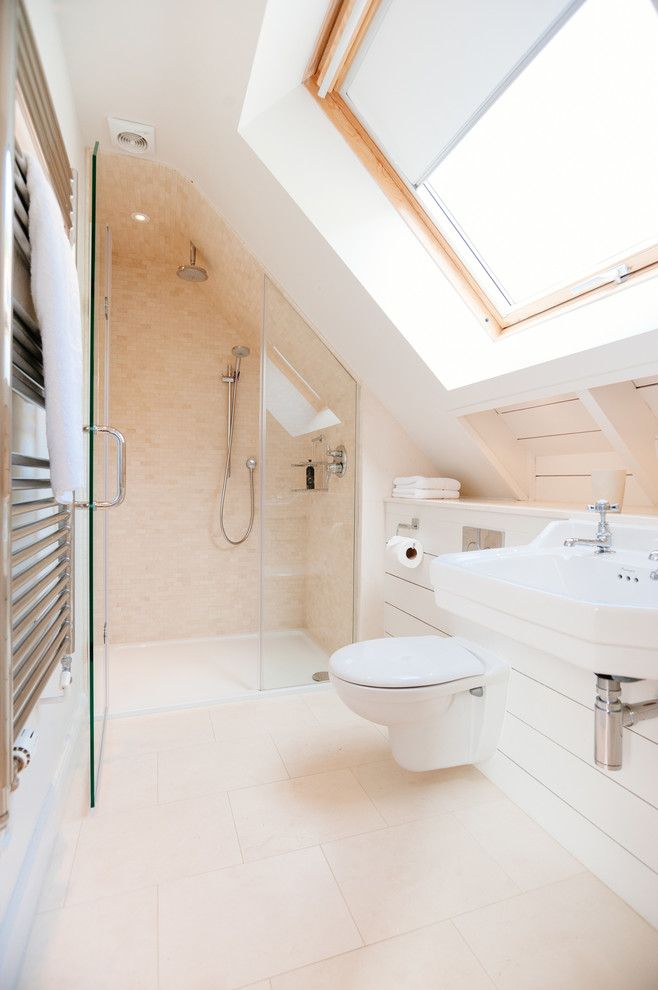 Inspiration for a coastal beige tile and mosaic tile alcove shower remodel in Cornwall with a wall-mount sink, a wall-mount toilet and white walls