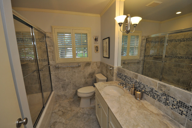 Tile and marble bathroom with window traditional-bathroom