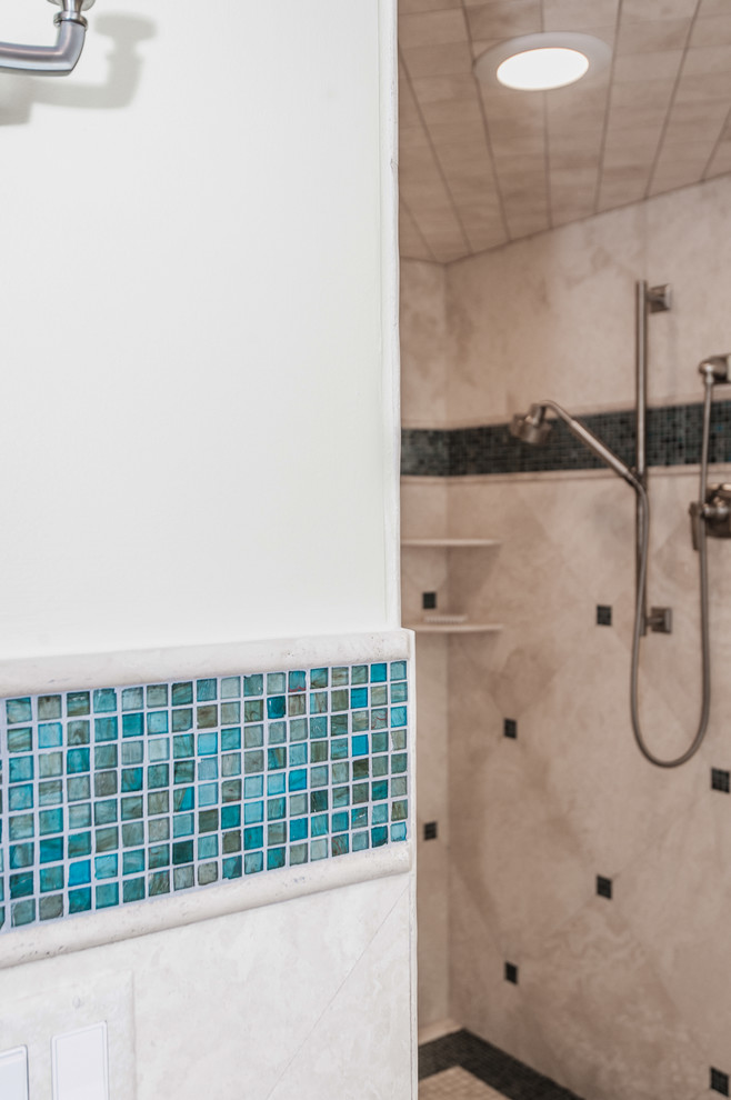 Inspiration for a large coastal master blue tile and mosaic tile mosaic tile floor bathroom remodel in Miami with shaker cabinets, light wood cabinets, a two-piece toilet, beige walls, an undermount sink and glass countertops