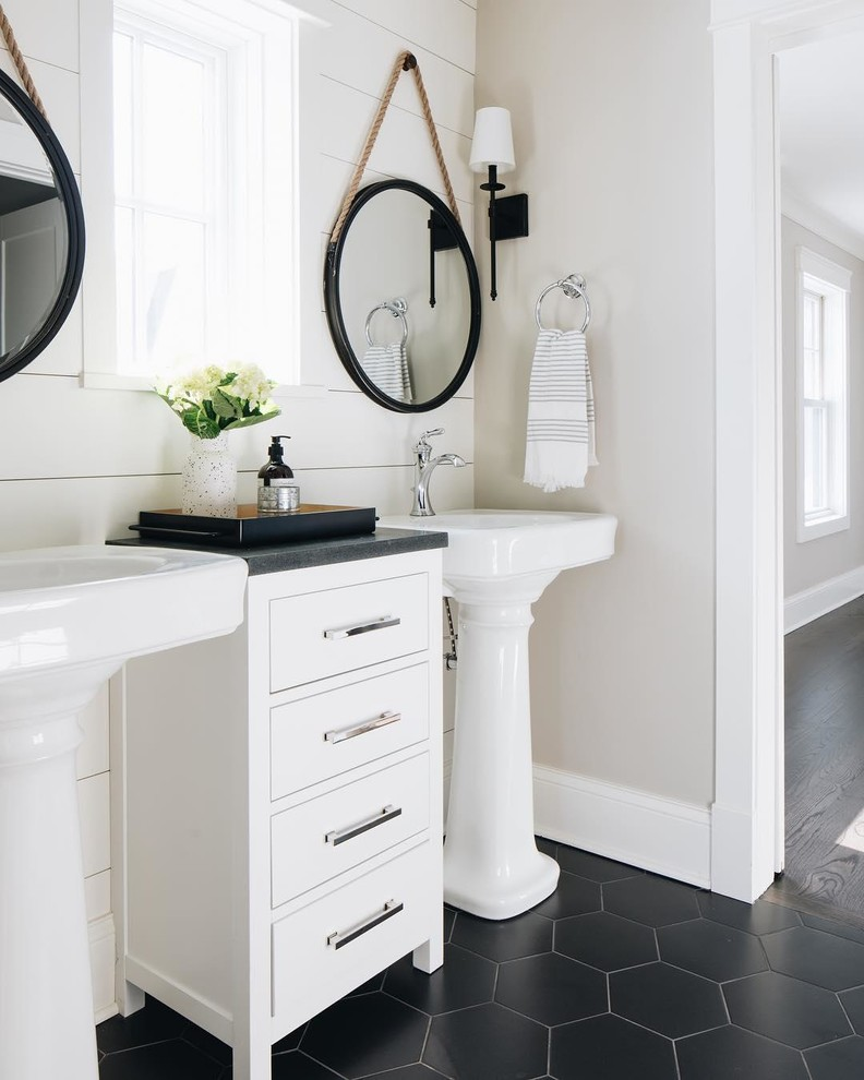 Inspiration for a cottage black floor bathroom remodel in Minneapolis with beige walls and a pedestal sink