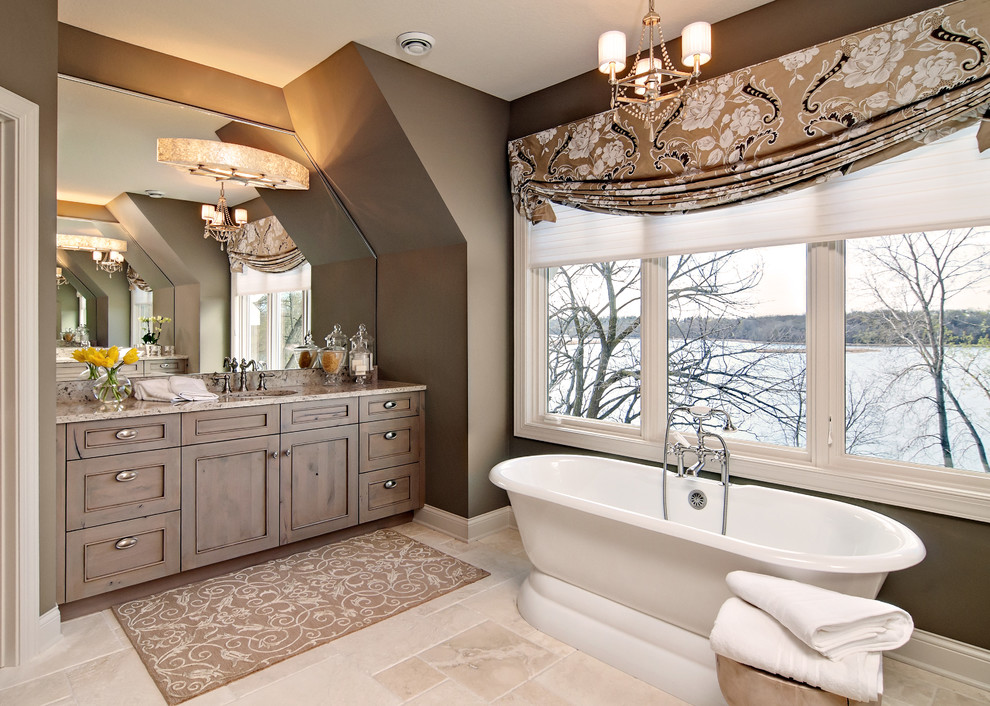 Inspiration for a large timeless master travertine floor freestanding bathtub remodel in Minneapolis with brown walls, beaded inset cabinets, medium tone wood cabinets, an undermount sink and granite countertops
