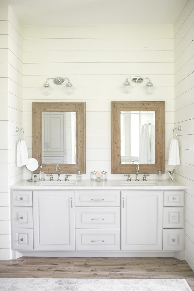 Freestanding bathtub - large farmhouse master freestanding bathtub idea in Houston