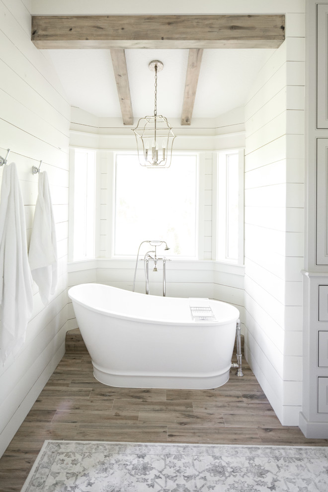 Inspiration for a large farmhouse master freestanding bathtub remodel in Houston