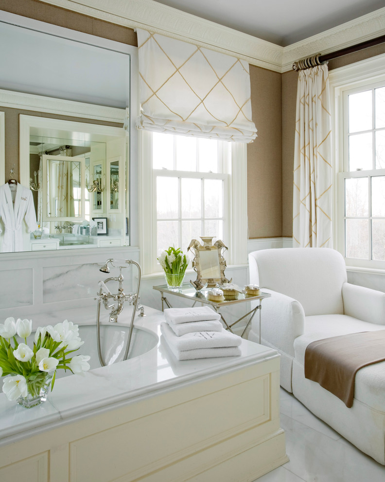 Inspiration for a timeless white tile bathroom remodel in New York with an undermount tub and brown walls