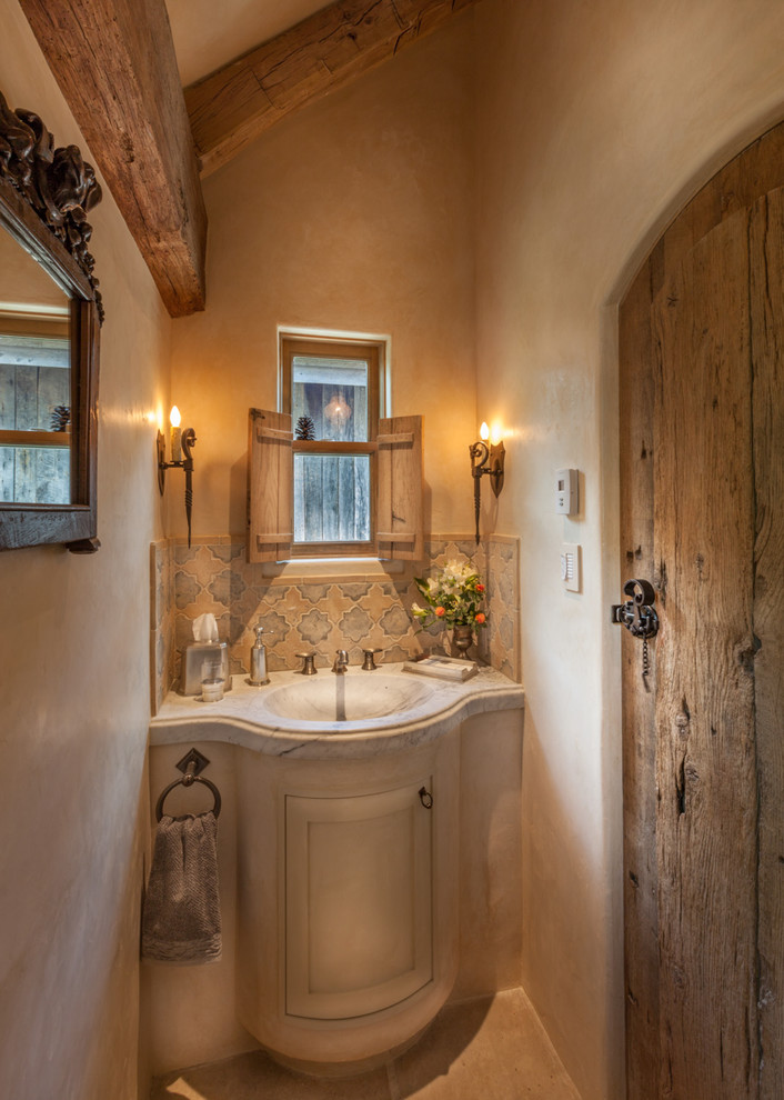 Bathroom - small traditional beige tile slate floor bathroom idea in Denver with beige cabinets, marble countertops, beige walls, an integrated sink and raised-panel cabinets