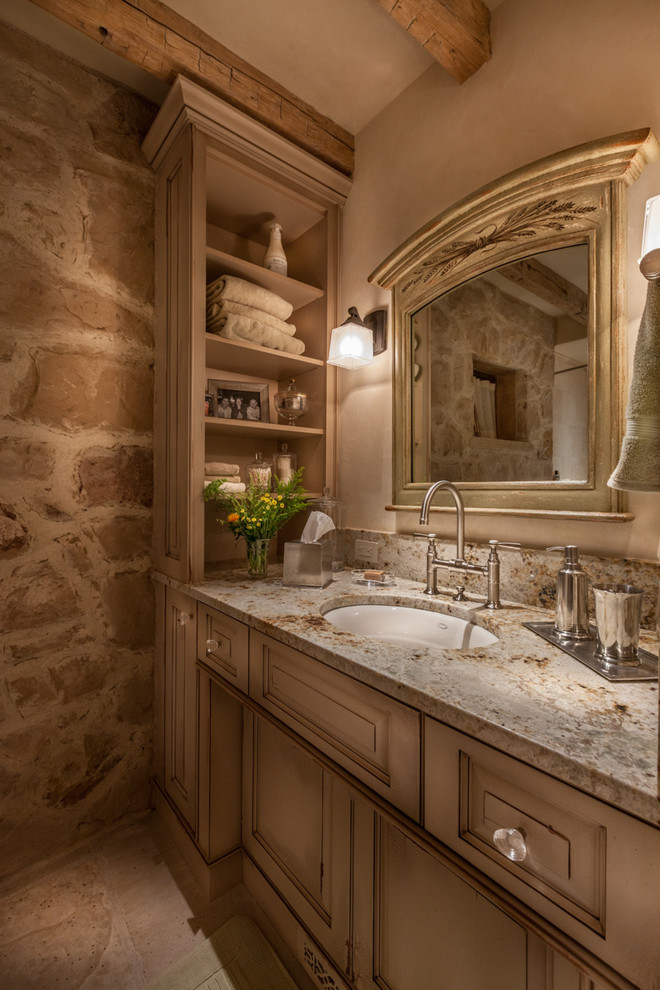 Bathroom - mid-sized traditional 3/4 beige tile porcelain tile bathroom idea in Denver with raised-panel cabinets, an undermount sink, distressed cabinets, beige walls and granite countertops