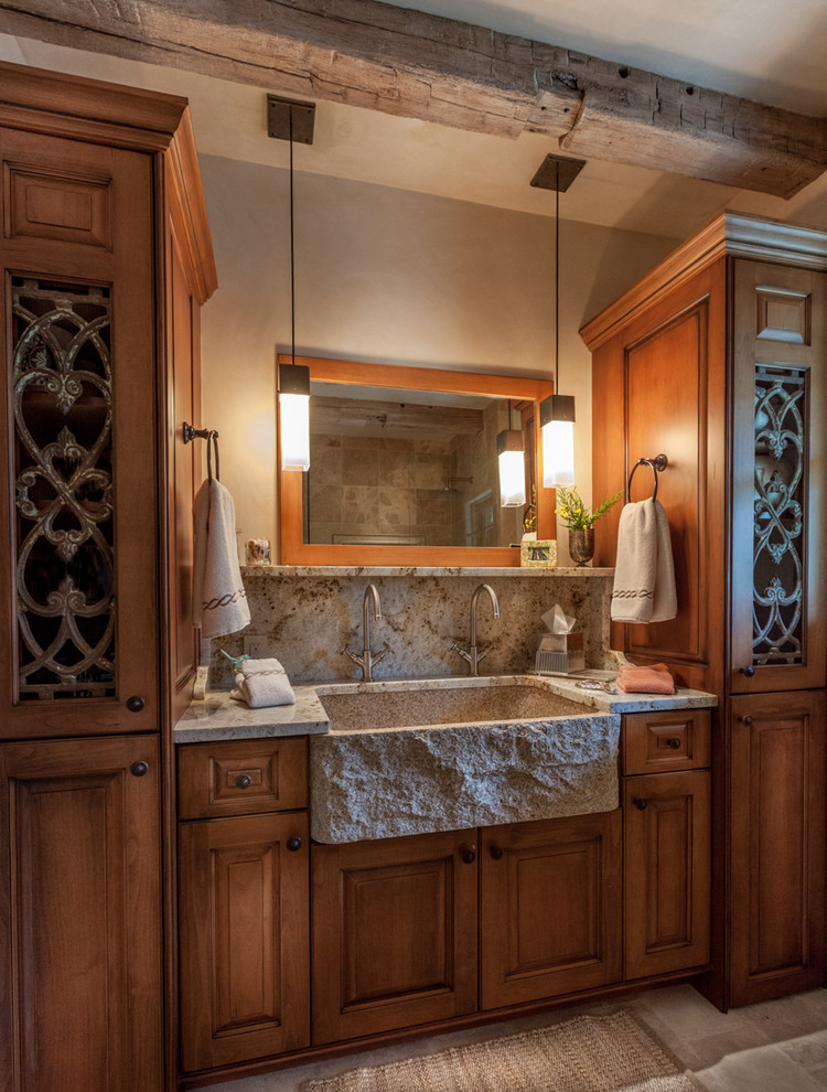 Mid-sized arts and crafts master beige tile slate floor bathroom photo in Denver with raised-panel cabinets, medium tone wood cabinets, beige walls, a one-piece toilet, an integrated sink and granite countertops