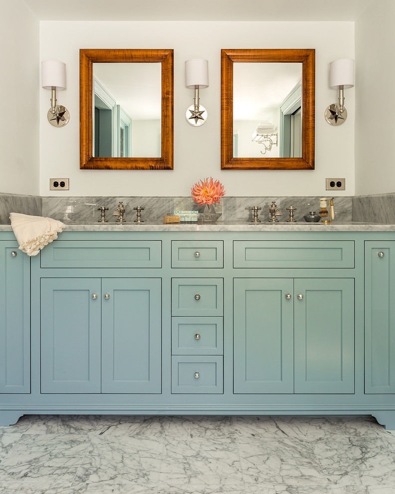 Example of a classic master marble floor bathroom design in Boston with an undermount sink, shaker cabinets, blue cabinets, marble countertops, white walls and gray countertops