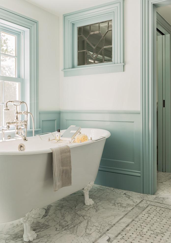 Claw-foot bathtub - traditional master marble floor claw-foot bathtub idea in Boston with multicolored walls