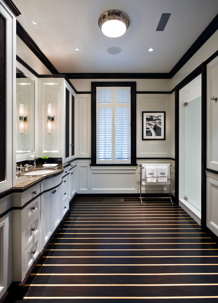 Elegant bathroom photo in New York with an undermount sink, recessed-panel cabinets and white cabinets